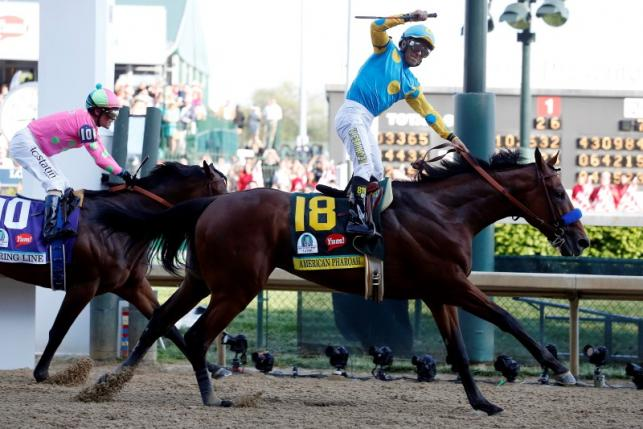May 2, 2015; Louisville, KY, USA; Victor Espinoza aboard American Pharoah celebrates winning the 141st Kentucky Derby at Churchill Downs. Mandatory Credit: Peter Casey-USA TODAY